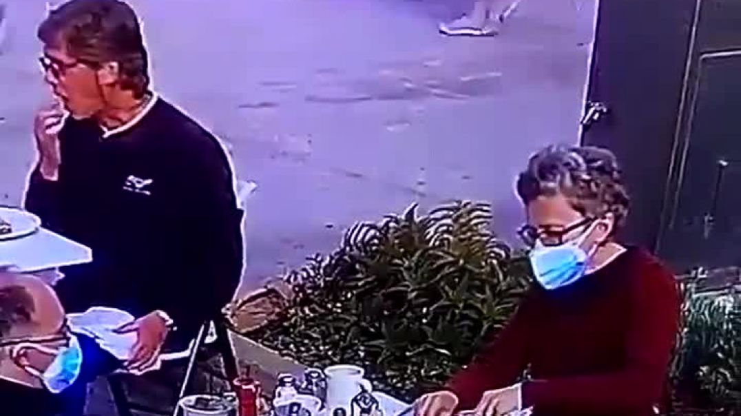 Crazy woman keeping her mask on between bites